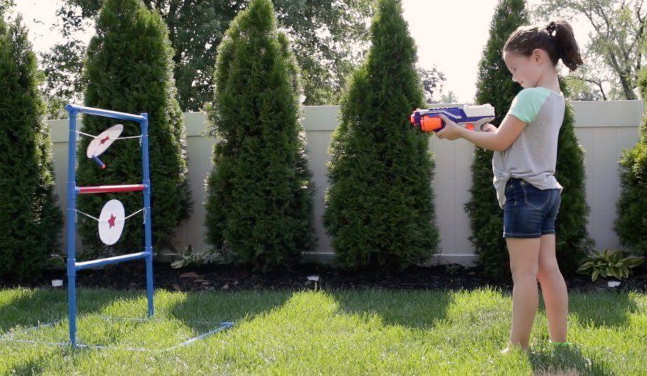 girl shooting target with nerf gun